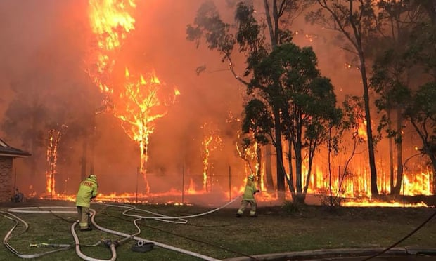 'The need to keep the wheels of capitalism well-oiled takes precedence even against a backdrop of fires, floods and hurricanes.' Photograph: Fire & Rescue NSW/AFP/Getty Images